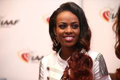Genzebe Dibaba speaks to the press in Monaco (Giancarlo Colombo / IAAF)