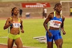 Kerron Stewart (right) races ahead of Shelly-Ann Fraser in the women's 100m heats (Sporting Eagle)