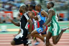 Kim Collins leads the final of the men's 100 metres (Getty Images)