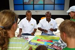 IAAF Ambassadors Allen Johnson and Colin Jackson sign autographs at the Samsung Champions Lounge at the Kultur Stadium in Berlin (Getty Images)