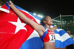 Yipsi Moreno of Cuba celebrates winning the hammer throw (Getty Images)