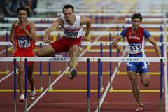 Artur Noga of Poland clears the last hurdle to win the men's 110m Hurdles final (Getty Images)