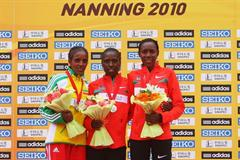 The women's podium in Nanning - runner-up Dire Tune (ETH), champion Florence Kiplagat (KEN), and bronze medallist Peninah Arusei (KEN) (Getty Images)