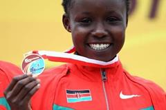 Mercy Cherono of Kenya celebrates her World Junior cross country gold medal in Bydgoszcz (Getty Images)