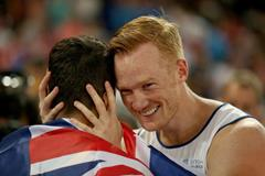 World long jump champion Greg Rutherford celebrates with silver medallist Fabrice Lapierre at the IAAF World Championships, Beijing 2015 (Getty Images)