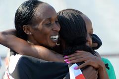 Gladys Cherono celebrates with her team-mates at the 2014 IAAF World Half Marathon Championships in Copenhagen (Getty Images)
