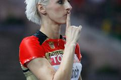 Germany's Ariane Friedrich silences the crowds in the Berlin Olympic Stadium before she takes a jump in the women's High Jump final (Getty Images)