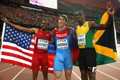 110m hurdles medallists Sergey Shubenkov (centre), Hansle Parchment (right) and Aries Merritt (left) at the IAAF World Championships, Beijing 2015 (Getty Images)