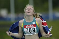 Sally McLellan of Australia celebrates winning the 100m Hurdles (Getty Images)