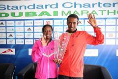Mulu Seboka and Tsegaye Mekonnen after winning at the 2014 Standard Chartered Dubai Marathon (Organisers / Giancarlo Colombo)