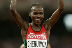 Vivian Cheruiyot after winning the 10,000m at the IAAF World Championships, Beijing 2015 (Getty Images)