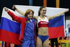Yelena Isinbayeva and Svetlana Feofanova of Russia win gold and bronze in the women's Pole Vault final (Getty Images)