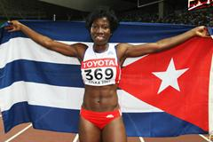 Yargelis Savigne of Cuba celebrates winning Triple Jump gold in Osaka (Getty Images)