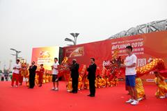 Dignatories and Chinese athletes at the 'One Year To Go' ceremony for the IAAF World Championships, Beijing 2015, including Liu Xiang and IAAF President Lamine Diack (centre) (IAAF / LOC)