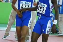 Team mates Marc Raquil and Leslie Djhone celebrate after the 400m final (Getty Images)