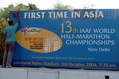 Signboard in New Delhi is cleaned in preparation for the 2004 World Half Marathon (AFP/Getty Images)