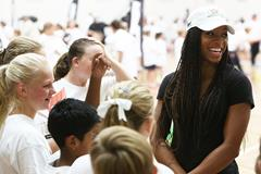 Natasha Hastings talks to the children at the launch of the IAAF Nestle Healthy Active Kids Athletics in Melbourne (Getty Images)