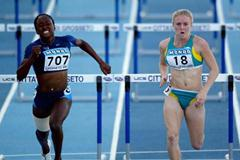 Ronetta Alexander of USA and Sally McLellan of Australia during the Women's 100m Hurdles Final (Getty Images)
