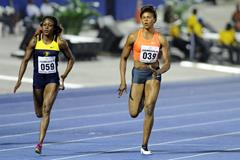 Elaine Thompson (left) winning the 100m at the 2015 Jamaica International Invitational in Kingston (organisers / Errol Anderson)