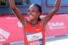 Rita Jeptoo of Kenya after winning the 2013 Chicago Marathon (Getty Images)