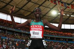 Linet Chepkwemoi Masai of Kenya celebrates winning the gold medal in the women's 10,000m (Getty Images)