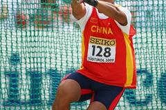 Hongqiu Chen of China on his way to winning the Boys' Hammer Throw final (Getty Images)