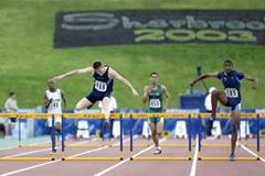 Jason Richardson on his way to winning gold in the 400m Hurdles (Getty Images)