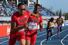 Wallace Spearmon (L) of the United States reaches back for the baton from Isiah Young as they compete in the Men's 4x200 metres relay  (Getty Images)