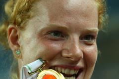 Betty Heidler of Germany receives the gold medal for winning the Women's Hammer Throw Final (Getty Images)