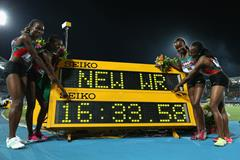 (L-R) Irene Jelagat, Faith Chepngetich Kipyegon, Mercy Cherono and Hellen Onsando Obiri of Kenya pose together after setting a new world record of 16:33.58 in the Women's 4x1500 metres relay  (Getty Images)