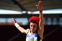 Tatyana Lebedeva supporting her lurid red hair-do, on her way to victory in Stuttgart (Getty Images)