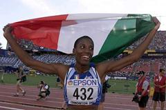 Long Jump Final - Fiona May with Flag (Getty Images)