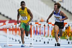 Stefan Fennell of Jamaica wins his Men's 110 metres Hurdles qualification heat on the day one of the 14th IAAF World Junior Championships in Barcelona (Getty Images)