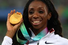 Lashinda Demus of the USA poses with the gold medal during the medal ceremony for the women's 400 metres hurdles (Getty Images)