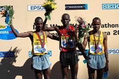 Podium of the men's race (IAAF)