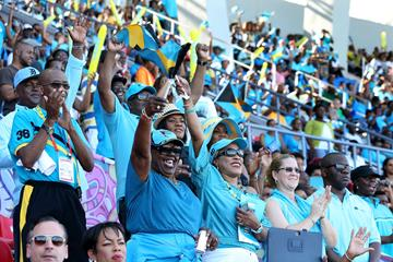 Fans cheer and wave flags during day one of the IAAF World Relays at the Thomas Robinson Stadium (Getty Images)