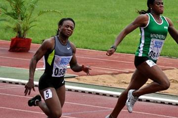 Ruddy Zang Milama of Gabon wins the women's 100m ahead of Blessing Okagbare (Yomi Omogbeja/AthleticsAfrica.Com)