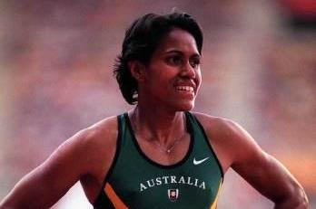 Cathy Freeman after winning the 400m at the 1999 IAAF World Championships (© Allsport)