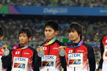 (L-R) Silver medallists Yukihiro Kitaoka, Yoshinori Oda, Yuki Kawauchi, Kentaro Nakamoto and Hiroyuki Horibata of Japan celebrate on the podium with their medals for the marathon team in Daegu 2011  (Getty Images)