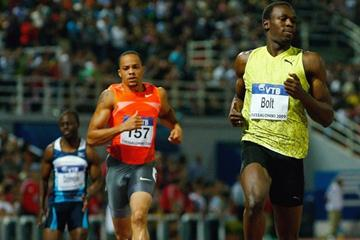 Usain Bolt eases down slightly before the line in the 200m as the clock stops at 19.68 (Getty Images)