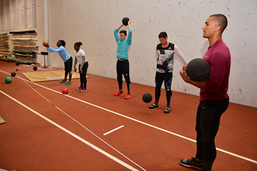 The 'On Camp' group do medicine ball drills with Ashton Eaton (Phil Johnson / TrackTown USA)