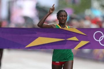 Tiki Gelana of Ethiopia celebrates as she crosses the finish line to win the gold medal in the Women's Marathon at The Mall on Day 9 of the London 2012 Olympic Games on August 5, 2012 (Getty Images)