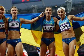 Bronze medalists Olesya Povh of Ukraine, Hrystyna Stuy of Ukraine, Mariya Ryemyen of Ukraine and Elyzaveta Bryzgina of Ukraine celebrate after the Women's 4 x 100m Relay Final of the London Olympic Games on 10 August 2012 (Getty Images)