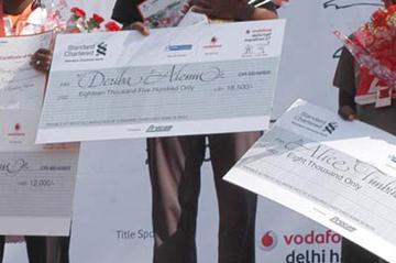 Derebe Alemu atop the podium after taking the New Delhi Half Marathon (VDHM Organisers)