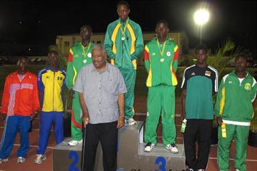 "Premier Ralph T. O'Neal who threw his support behind the BVI Athletics Association's hosting of the XIV CAC Age Group Championships, poses with the 13-14 Boys Shot Putters after presenting them with awards (Dean ""The Sportsman"" Greenaway )"