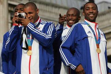 Darren Campbell (right) celebrates with Relay team mates in London's Olympic parade 18 Oct - (l to r) Lewis-Francis, Gardener, Devonish (Getty Images)