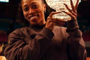 Gail Devers, after her American record win at the 2003 Millrose Games trophy (Kirby Lee)