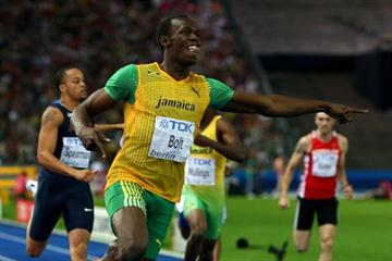 Jamaica's Usain Bolt points at the clock showing the new 200m World Record of 19.19 seconds at the 12th IAAF World Championships in Athletics in Berlin (Getty Images)