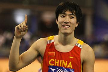 Liu Xiang celebrates his 60m hurdles victory (Getty Images)