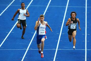 (L-R) Quaski Itaia of Nauru, Christophe Lemaître of France and Chi Ho Tsui of Hong Kong in the 6th heat of the 100m heats (Getty Images)